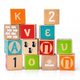 Ξύλινοι κύβοι οξιάς με αριθμούς, γράμματα και σχήματα